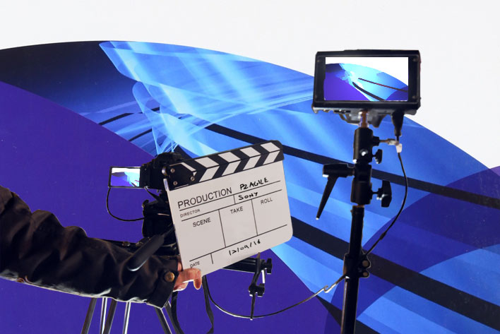 Camera and clapperboard in front of a PRINCE2 Agile background