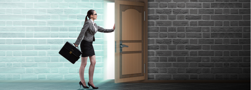 Female business women, opening a door