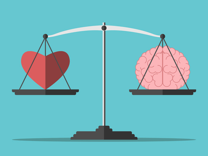 Heart and brain on a scale to represent emotional intelligence